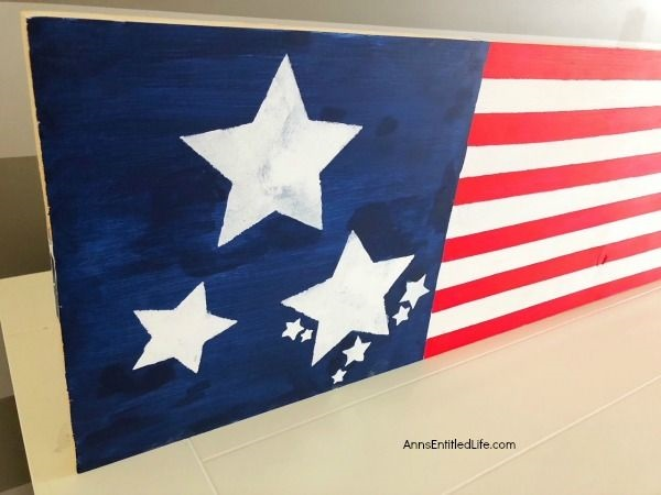 Wooden American Flag DIY Craft. This rustic American flag craft project is simple to make. Large enough for outdoor use, this rustic American flag craft can also be used inside the house. These easy step by step instructions in this short tutorial will show you how to make this wooden American flag craft is no time flat!