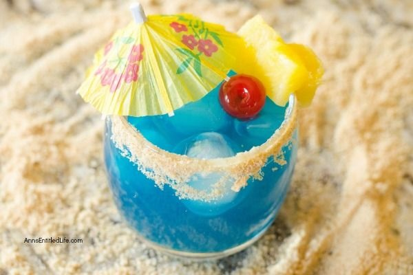 Blue Mermaid Cocktail Recipe. A tropical delight, this mermaid themed cocktail recipe might also be referred to as mermaid water! If you are looking for a tasty and delightful summertime fun cocktail recipe, give this fabulous blue mermaid cocktail a try. Yum!