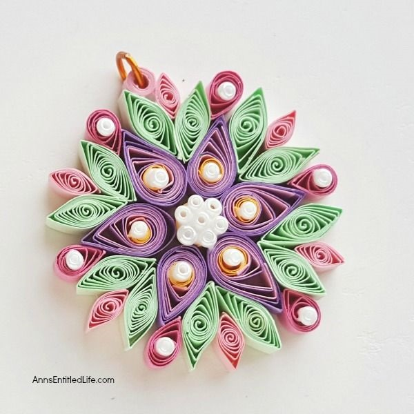 How to Make a Flower Quilling Pendant Necklace. Use these easy step by step instructions to make a beautiful flower pendant with quilling paper strips. This lovely pendant can be customized to any color to personalize your flower quilling pendant necklace to your exact taste. If you are interested in making quilling jewelry, start here!