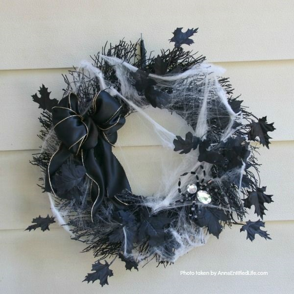 DIY Spooky Spider Halloween Wreath. This simple to make homemade Halloween wreath is spook-tacular - and takes only 15 minutes to put together. If you are looking for easy do it yourself Halloween decor, look no further than this DIY Spooky Spider Halloween Wreath, and make one today!