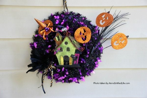 Haunted House Halloween Wreath. This whimsical haunted house Halloween wreath is an easy to put together - truly a 15-minute craft!  If you are looking for simple Halloween wreath ideas, look no further than this fun haunted house Halloween wreath DIY.