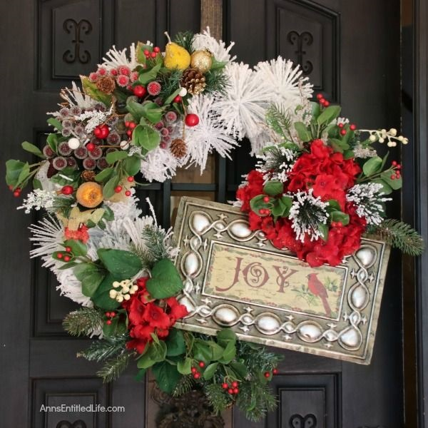 Cranberry Holly Winter White Wreath DIY. This beautiful Cranberry Holly Winter White Wreath is a simple rustic wreath that appears time-consuming, but actually comes together in under 30 minutes! Follow these easy step by step directions to make your own lovely custom Christmas door hanger wreath.