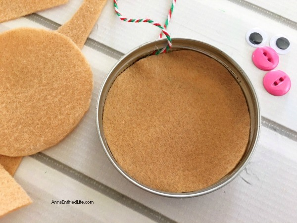 Gingerbread Man Mason Jar Lid Ornament DIY. Give your Christmas tree a personal touch and make your own ornaments this holiday season. Follow these step-by-step tutorial instructions to make this adorable Gingerbread Man Mason Jar Lid Ornament!