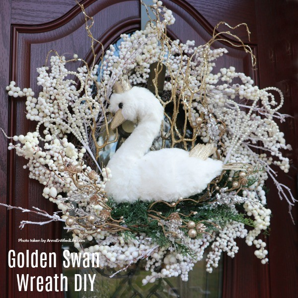 Golden Swan Wreath DIY. This stunning wreath takes only 15 minutes to make! Perfect for so many holidays, party functions (think bridal or shower), or as a year round wreath with a bit of bling, this unusual swan wreath is lovely wall décor or door décor!