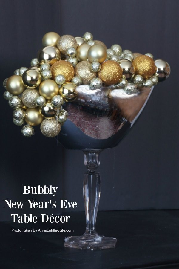 Bubbly New Year's Eve Table Décor. This upcycled New Year's Eve décor is a great celebration centerpiece! You can use this champagne bubbly inspired craft for your champagne party, as an accent at a party bar or as fun décor at any cocktail party - or simply leave it up year-round on your wet bar. Super easy to make, this Bubbly New Year's Eve Table Décor piece can be made in gold, silver, copper, rose gold, or pink champagne colors for a great added sparkle decoration adorning your party tabletop arrangement.