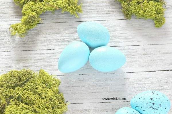 Hand Painted Robin Eggs Bird Nest Décor. These beautiful blue robin eggs make perfect springtime décor! Simple to make, these robin eggs are ready in no time flat. Your centerpiece never looks so festive with so little effort! These are great for Easter too. Simply follow this easy step-by-step tutorial to make your stunning spring centerpiece, tabletop side piece, or mantel decoration, today!