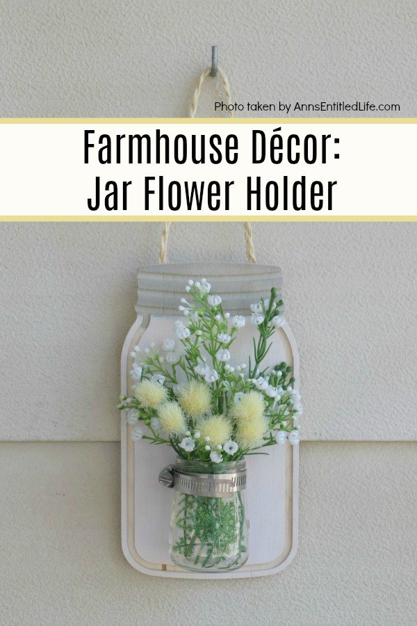 Farmhouse Décor: Jar Flower Holder. This adorable little jar flower holder is easy to make, rustic decor. Great for indoor or outdoor decorating, this sweet little bud vase fills in that small section of open wall space perfectly. This step-by-step tutorial will show you exactly how to make this simple DIY farmhouse décor jar flower holder inexpensively.