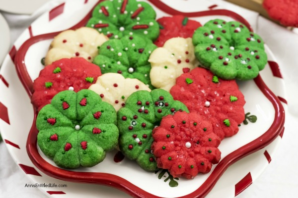 Spritz Cookie Recipe. This delicious, classic spritz cookie is a holiday cookie favorite. This fabulous recipe colors beautifully, tastes fantastic, and is very easy to make. This spritz cookie recipe freezes very well. Make these mouthwatering spritz cookies part of your holiday tradition. Yum!