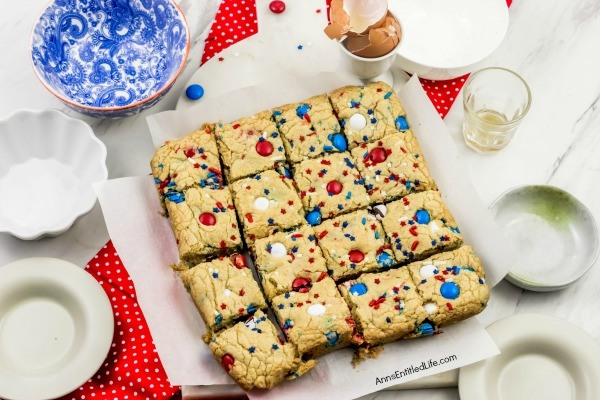 Fireworks Blondies Recipe. These fun, easy to make Fireworks Blondies are the perfect treat for your patriotic celebration. These delicious little bars transport well. Add M&Ms, sprinkles, red, white, blue jimmies or stars to customize your Independence Day dessert.