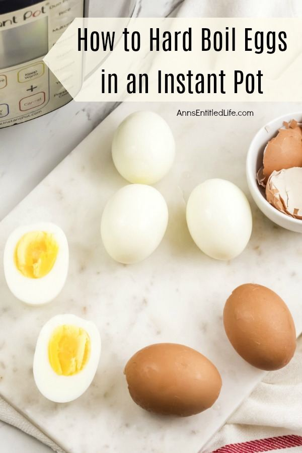 4 peeled hard-boiled eggs, one cut in half, 2 brown hard boiled eggs, instant pot in background, bowl of egg shells on the right