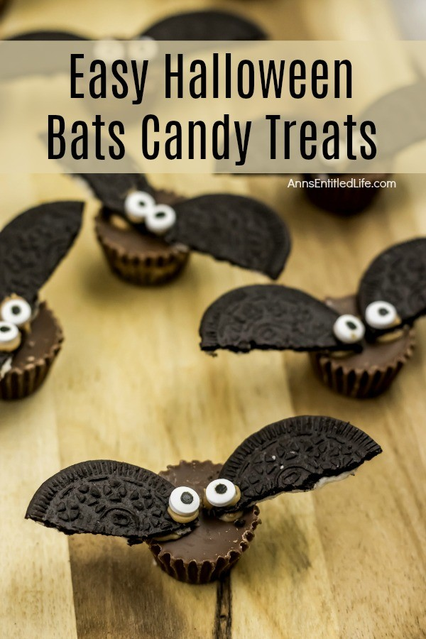 6 candy treats made up to look like bats, on a butcher block cutting board