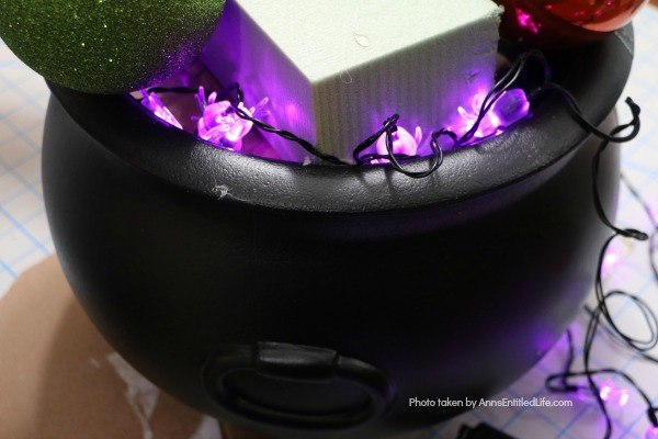 Homemade Halloween Witch's Cauldron. Make these adorable witches cauldrons for Halloween this year. This homemade cauldron packs a real visual punch. Beautiful to look at, creepy without being scary, this homemade Halloween witch's cauldron is great for Halloween décor, delight trick-or-treaters, or as a fabulous Halloween party prop.