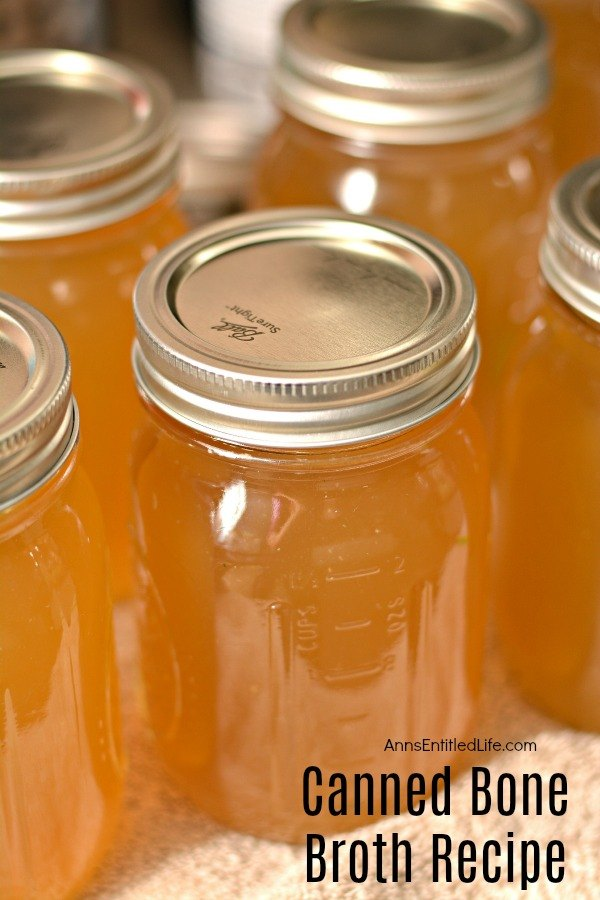 close-up of five jars of canned bone broth on a table