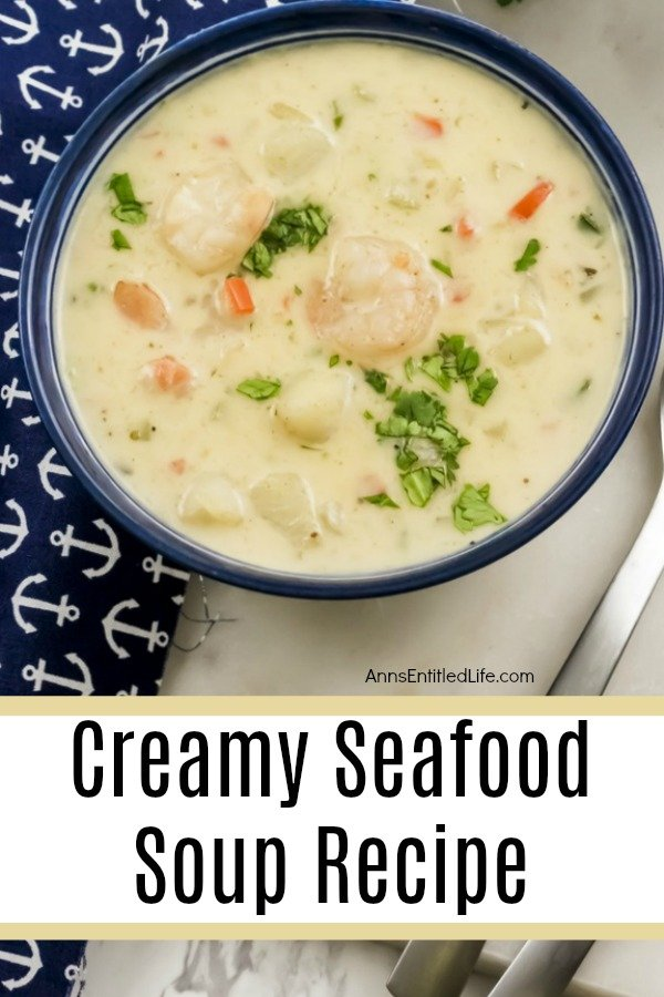 creamy seafood soup in a blue bowl on top of a blue anchor patterned napkin