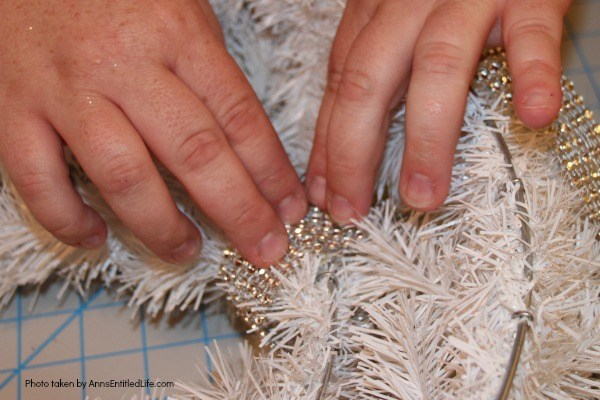 Let It Snow Wreath. This beautiful, bling-y let it snow wreath is so easy to make! If you are looking for a fun and simply winter craft project to hang on your front door or over your fireplace mantel, you will want to make this sparkly winter wreath.