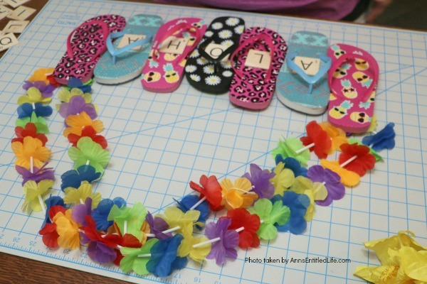 Flip Flops Door Hanger: Dollar Store Craft. Make this cute flip flop door hanger in no time flat with materials found at your local dollar store! This quick and easy project is inexpensive and great for summertime, tropical parties, or classroom decorations.