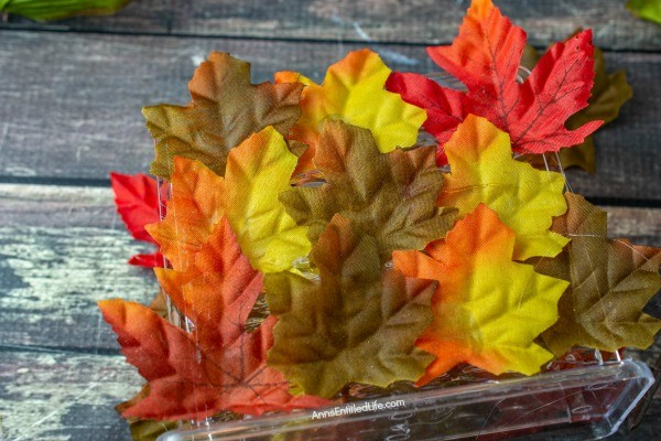 Autumn Leaf Napkin Holder: Dollar Store Craft. If you are looking for a fun, easy to make fall craft to dress up your kitchen counter or table, make this simple fall foliage napkin holder! Filled with acorns, leaves, and fall flowers, you can effortlessly make some autumn decor to make your house part of the fall season.