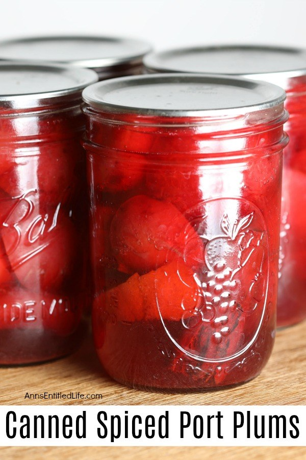 Close-up of pint jars of canned red plums