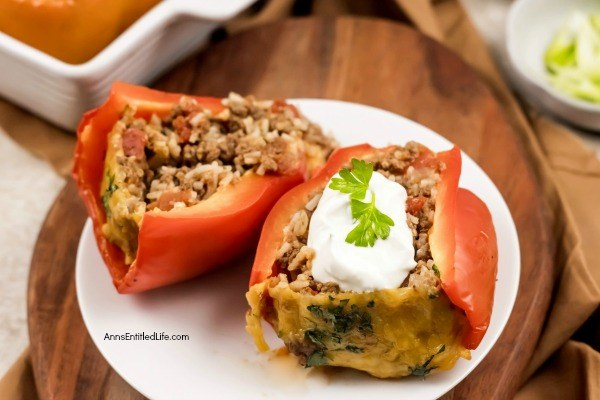 Stuffed Bell Peppers Recipe. These stuffed bell peppers are a classic recipe. Made with a mixture ground beef, rice, onions, tomatoes, and spices, this easy to make bell peppers recipe is the perfect family dinner any time of year!