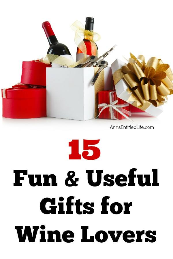 A white gift box is in the center with two bottles of wine and a corkscrew popping out, there are two oval red gift boxes to the left, and a two red boxes to the right. The white lid with a gold bow is partially blocking those two red boxes.