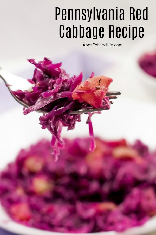 A close-up of a forkful of Pennsylvania red cabbage with a bowl filled with the cooked cabbage in the background.