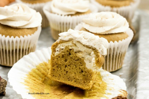 Pumpkin Cheesecake Cupcakes Recipe. Now that the weather has turned cooler, it is pumpkin season! These terrific cheesecake filled pumpkin cupcakes are frosted with an easy to make, complimentary brown sugar buttercream frosting. Whip up a batch tonight for lunchboxes, after-school snack, or dessert.