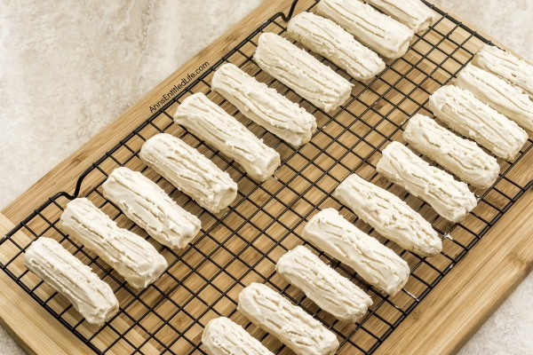 Rum Logs Recipe. Delicious, light and a touch sweet, these Rum Logs are a festive, melt-in-your mouth holiday cookie your entire family will enjoy. Perfect on a cookie tray or when you want a light sweet treat, this rum logs recipe is easy to make and requires no chill time for the dough!