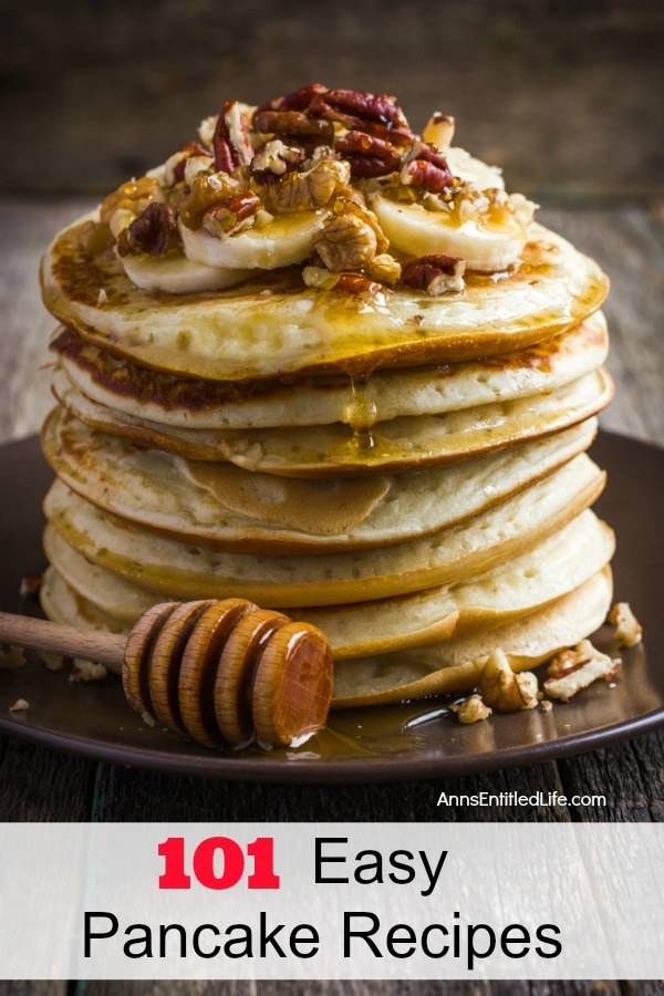 a stack of banana nut pancakes smothered in honey, on a dark plate set against a dark background.