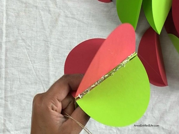 Paper Christmas Ornaments DIY. These paper Christmas ornaments are the easiest homemade ornaments you could make! Fully customizable to match any color scheme and they can be made as full or as slim as you like, these ornaments take about 5-minutes to make.