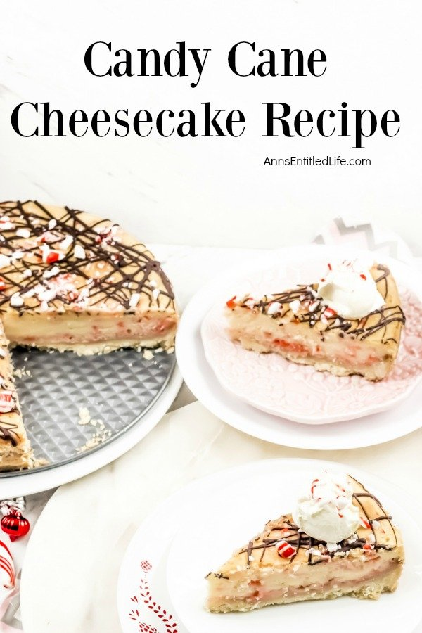 Two cut pieces of candy cane cheesecake sit on white plates, the remains of the whole cheesecakes sits to the left.