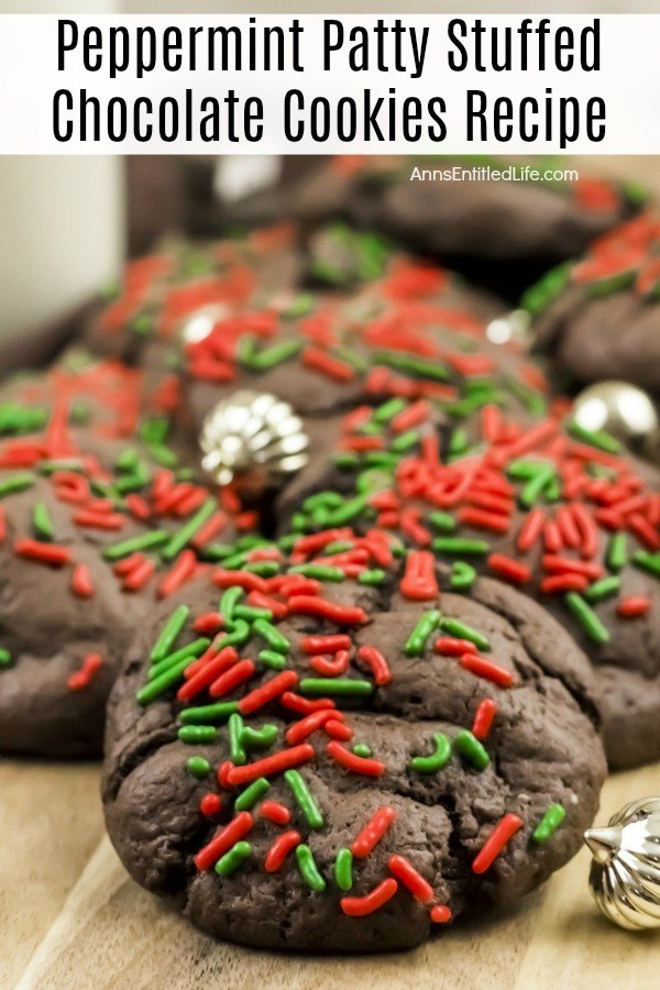 An up-close look at a cutting board filled with peppermint patty chocolate cookies. There are small gold ornaments decorating the pile.