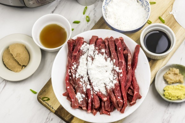 Instant Pot Mongolian Beef Recipe. Mongolian beef is a classic dinner entree, and this instant pot recipe is simple to make. Serve with rice and a green vegetable for a delicious dinner your entire family will love.