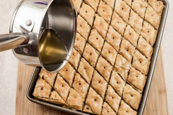 Baklava Recipe: How to Make the Best Honey Baklava. This easy step-by-step tutorial and my expert advice will help you make the best honey baklava for your friends and family to enjoy. This traditional Greek baklava recipe is easy-to-make, from scratch, and tastes fantastic. It is one of the best desserts of all time! This sweet dessert is made with layers of nuts, layers of flaky phyllo pastry, and rich honey syrup.