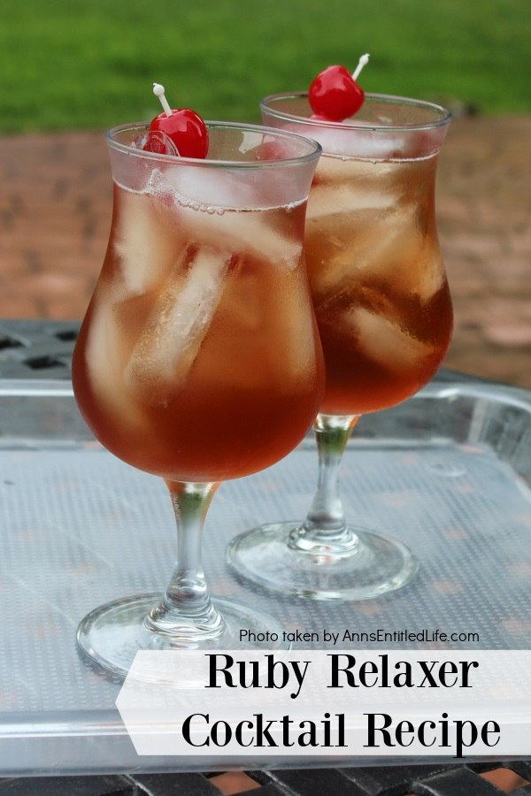 Two glasses of ruby relaxer cocktail set on a plastic tray in a backyard