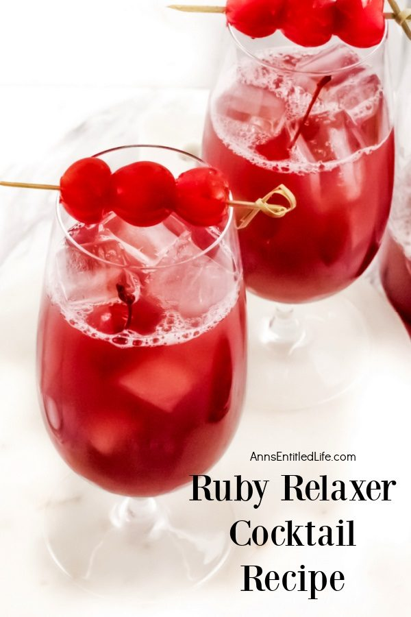 Two glasses ruby relaxer cocktail set on a white tray