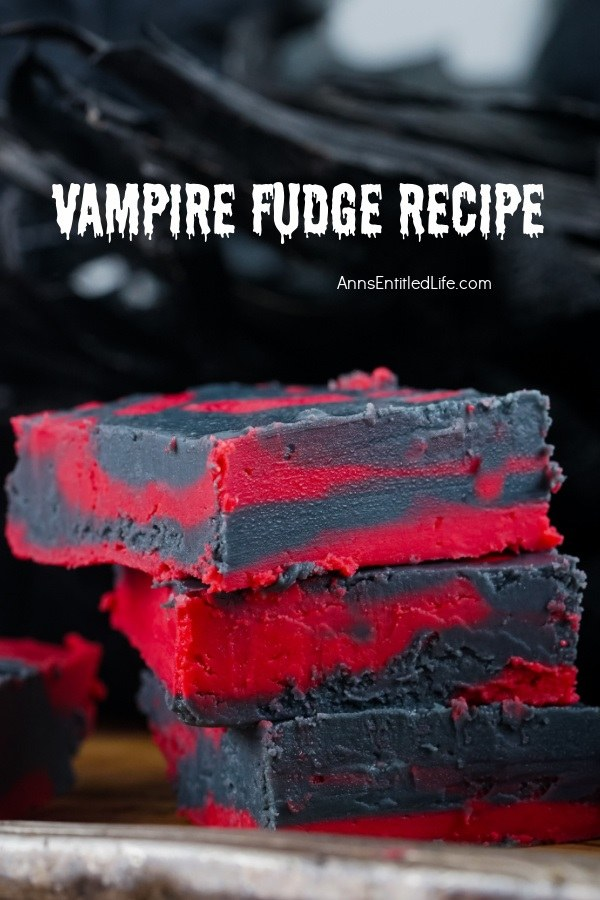 Three pieces of stacked red and black fudge set against a black background.