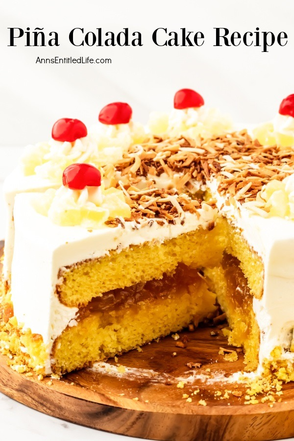 A pina colada cake cut open to show the filling and cake inside