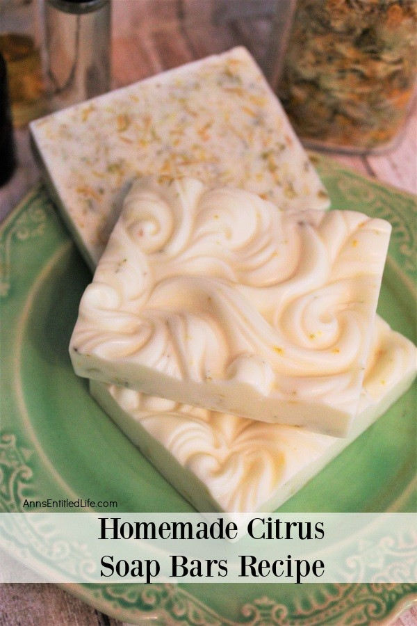 3 bars of citrus soap on a green plate, two showing the patterned top, one showing the back